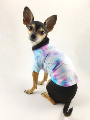 Swagadelic Unicorn Tie Dye Tee - Cute Chihuahua named Hugo in sitting position with his back towards the camera and looking back, wearing the hand tie-dyed tee with Pink and Sky Blue