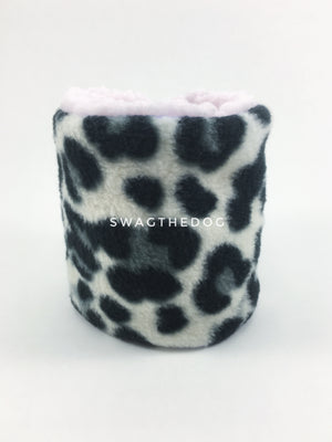 Gray Snow Leopard Swagsnood - Product Front View. Gray snow leopard print fleece Dog Snood and pink sherpa peeking out