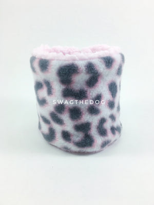 Pink Snow Leopard Swagsnood - Product Front View. Pink snow leopard print fleece Dog Snood and pink sherpa peeking out