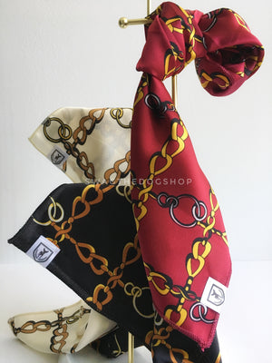 Three 24K Gold Swagdana Scarves displayed hanging. Vanilla. Black. Burgundy. Dog Bandana. Dog Scarf.