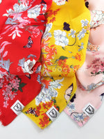Take an advantage of 3 for $30 deal. 3 Wild Flower Swagdana Scarves displayed. 1-Red Wild Flower. 2-Yellow Wild Flower. 3-Pink Wild Flower. Dog Bandana. Dog Scarf