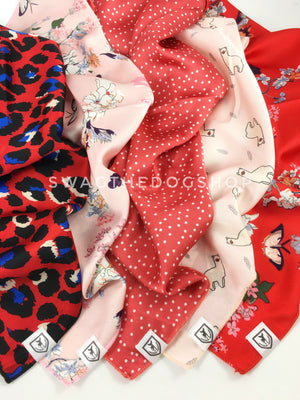 Take an advantage of 3 for $30 deal. 5 Shades of Red/Pink/Coral Color Theme Swagdana Scarves displayed. 1-Fierce Vibrant Red with Blue. 2-Pink Wild Flower. 3-Polka Itty Bitty Coral. 4-Lorenzo Llama Pink. 5-Red Wild Flower. Dog Bandana. Dog Scarf