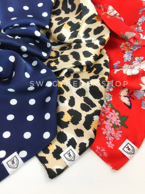 Take an advantage of 3 for $30 deal. 3 Blue/Beige/Red Color Theme Swagdana Scarves displayed. 1-Polka Dot Navy. 2-Fierce Beige with Yellow. 3-Red Wild Flower. Dog Bandana. Dog Scarf