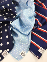 Take an advantage of 3 for $30 deal. 3 Blue Color Theme Swagdana Scarves displayed. 1-Polka Dot Navy. 2-Polka Itty Bitty Powdered Blue. 3-Afternoon in Paris. Dog Bandana. Dog Scarf