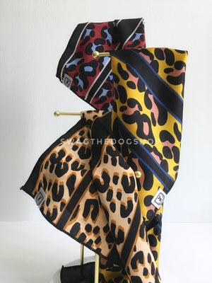 Take an advantage of 3 for $30 deal. 3 Leopard Print Swagdana Scarves displayed hanging. 1-Leopard Burgundy. 2-Leopard Sunflower Yellow. 3-Leopard Camel. Dog Bandana. Dog Scarf