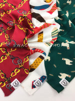 Take an advantage of 3 for $30 deal. 3 Red/ White/ Green color theme Swagdana Scarves displayed. 1-24K Burgundy Gold. 2-Rock Your Socks. 3-Lorenzo Llama Green. Dog Bandana. Dog Scarf