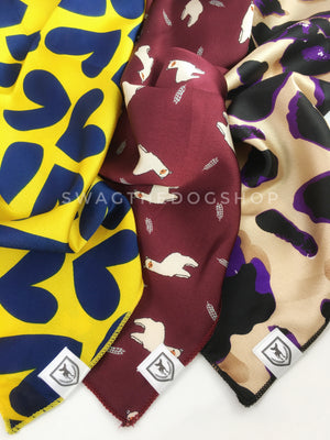 Take an advantage of 3 for $30 deal. 3 Yellow/ Red/ Beige color theme Swagdana Scarves displayed. 1-Full of Heart Royal Yellow. 2-Lorenzo Llama Burgundy. 3-Fierce Beige with Purple. Dog Bandana. Dog Scarf