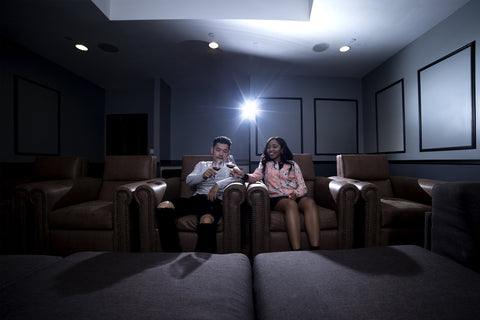 couple in home theater on zero gravity recliners