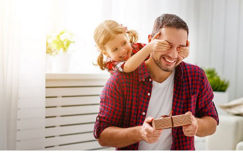 a child giving their father a fathers day gift