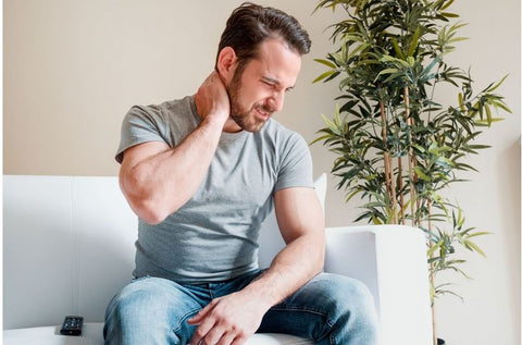 a man suffering from neck and back pain