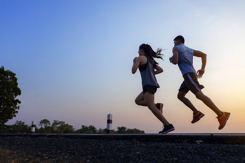 male and female fitness enthusiasts running