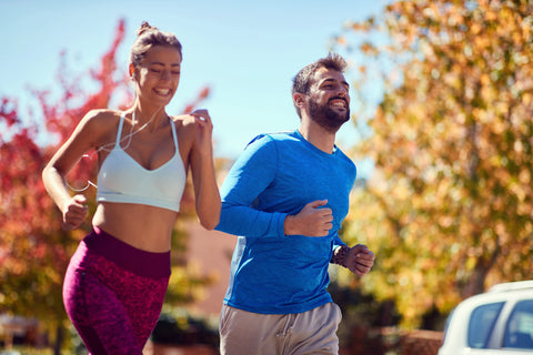 man and woman jogging as new year resolution