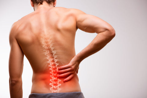 man experiencing different types of back pain