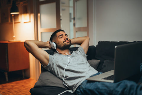 man listening to music before bed