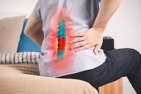 man with back pain learning how to heal a herniated disc