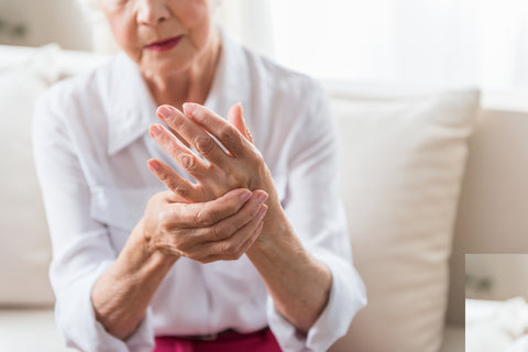 older woman suffering from arthritis and age related diseases