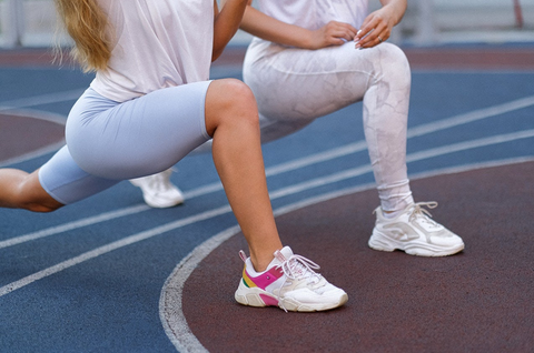 two athletes stretching before a jog