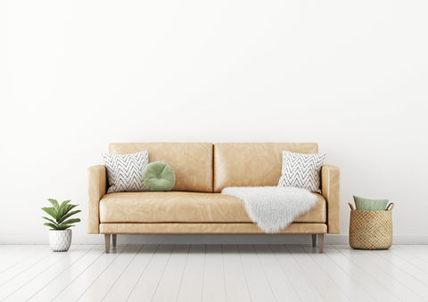 vegan leather couch with faux fur throw sustainable home decor