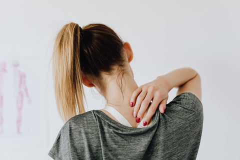 woman practicing what's good for back pain at home