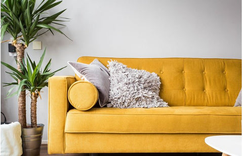 yellow sofa in family room