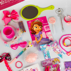There is a Disney Princess Sophia coloring book, a green mirror, a magenta unicorn hair bow, a lollipop swirl, a scepter pen, a little girl rainy cloud hair bow, a pair of magenta glasses, a magenta slinky, a princess braid, a glitter unicorn pen for girls, a princess tiara, crayons, a strawberry bracelet.