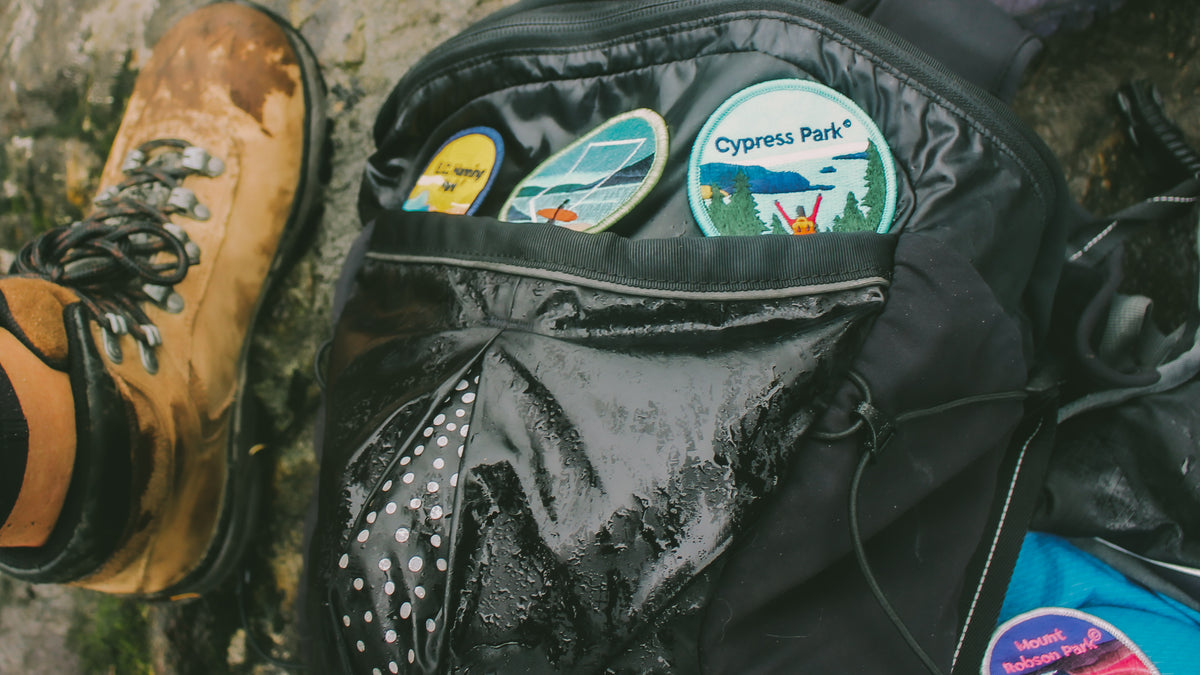 BC Parks Foundation patches on a wet backpack