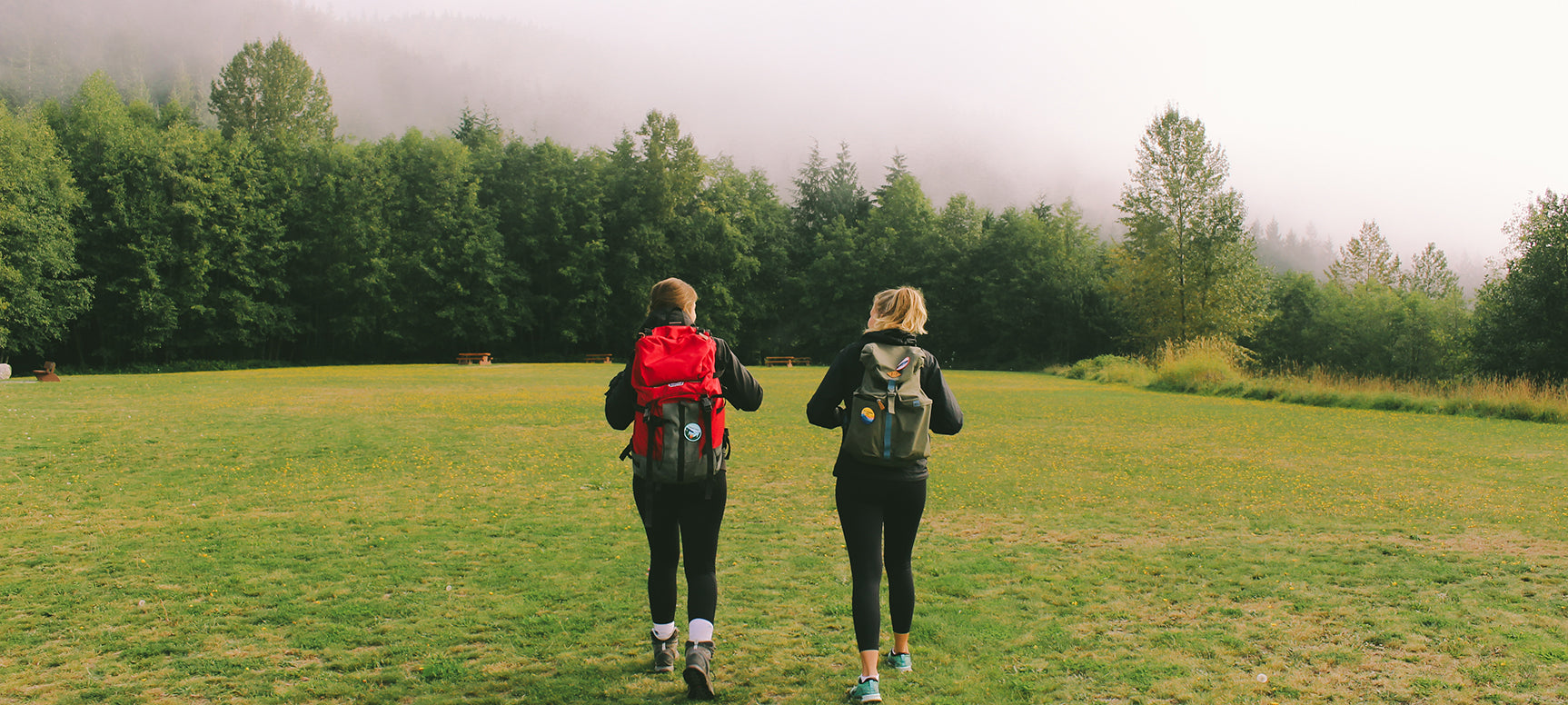 Women hiking with BC Parks Foundation patches