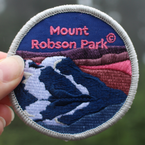 BC Parks Foundation Mount Robson Park patch held up outside