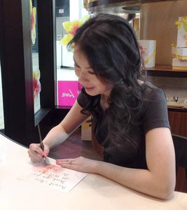 Barbara Kua at on site calligraphy event in Toronto