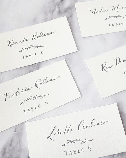 Grey Calligraphy Escort Cards with leaf detail
