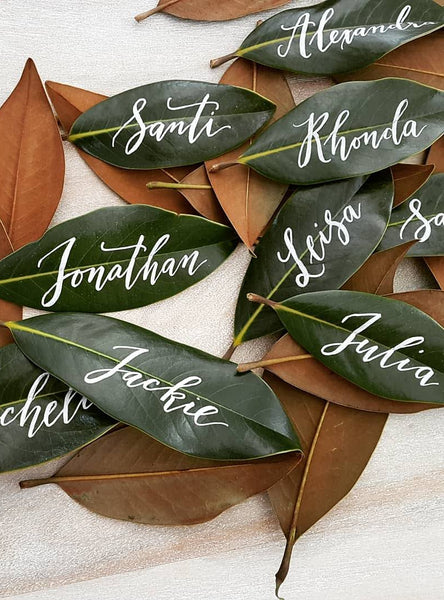 Magnolia Leaf Place Cards with White Calligraphy