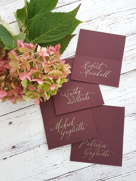 Merlot place cards with gold Calligraphy
