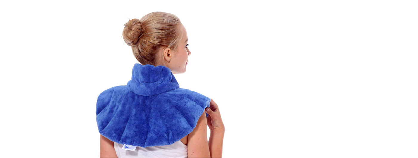 Young woman wearing a Huggaroo neck and shoulder wrap heating pad