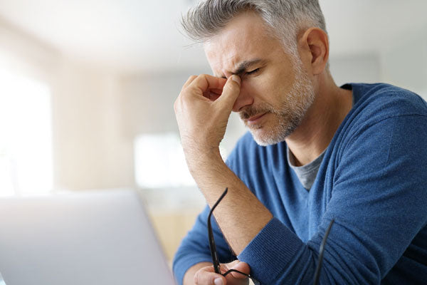 Man suffering from a bad tension headache