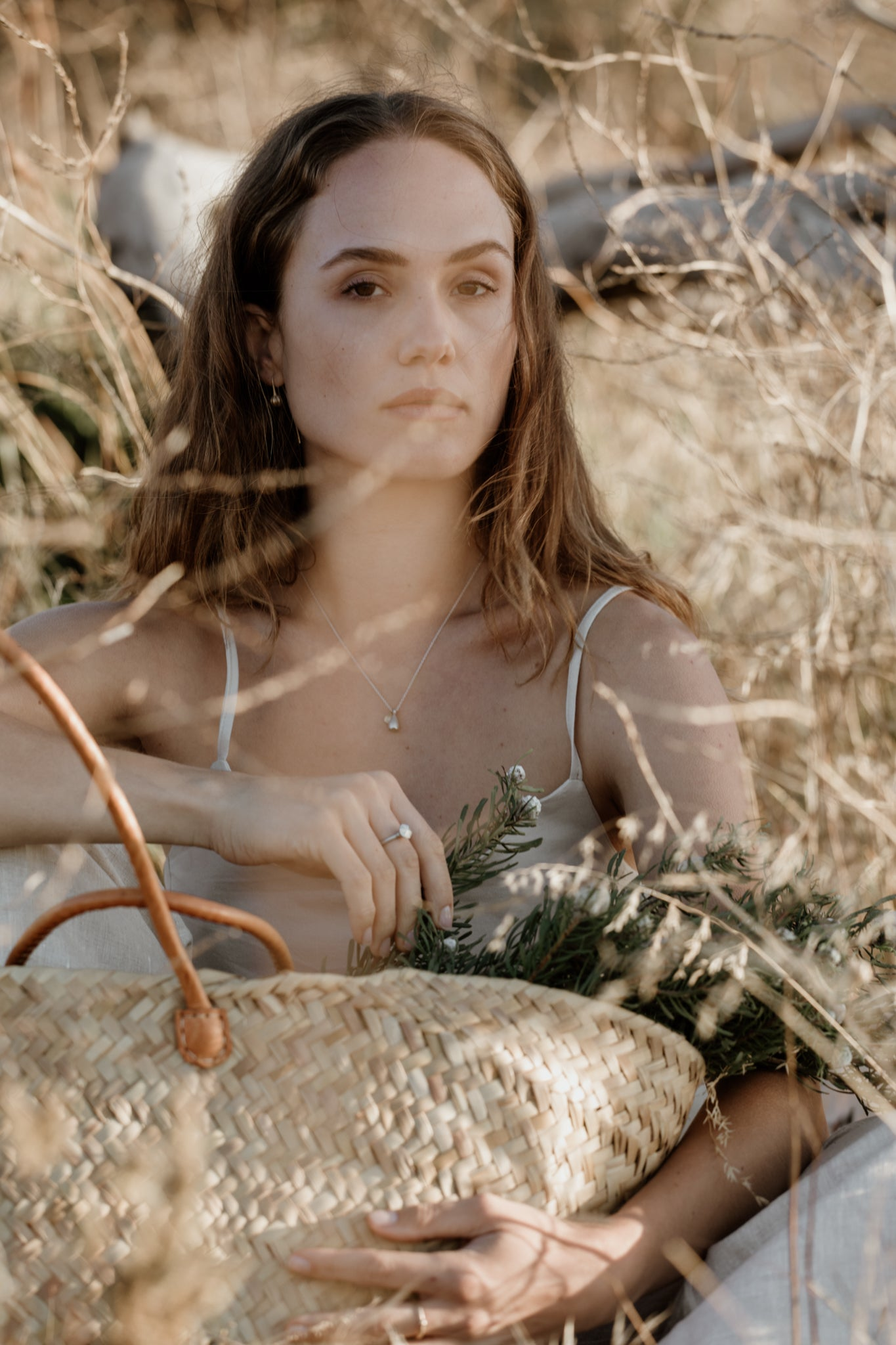 Model in grassland with eco-friendly recycled silver and gold jewellery