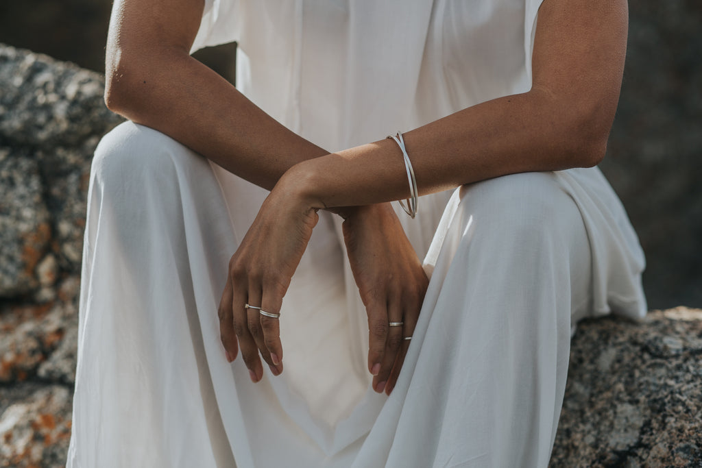 Eco-friendly recycled silver Oval Bangles glinting in the sun