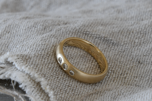 Recycled gold wedding band with 3 heirloom ethical diamonds
