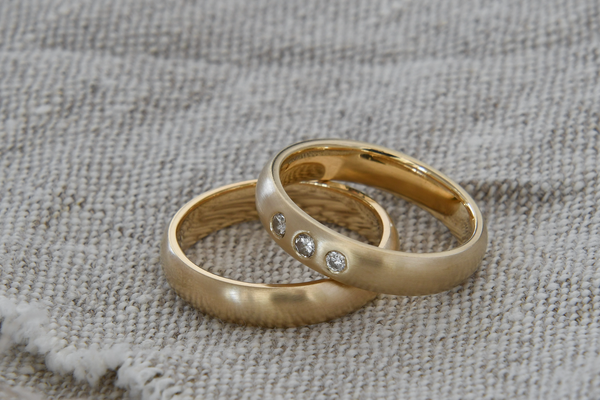 Rings handcrafted in gold recycled from e-waste and heirloom diamonds