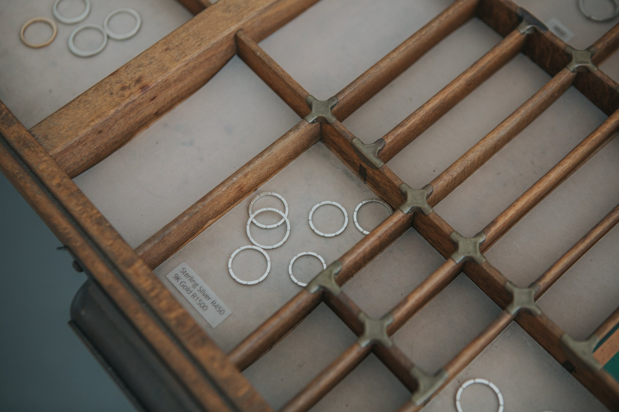 Silver and gold ethical, ecofriendly rings handcrafted in recycled e-waste in an old printers tray