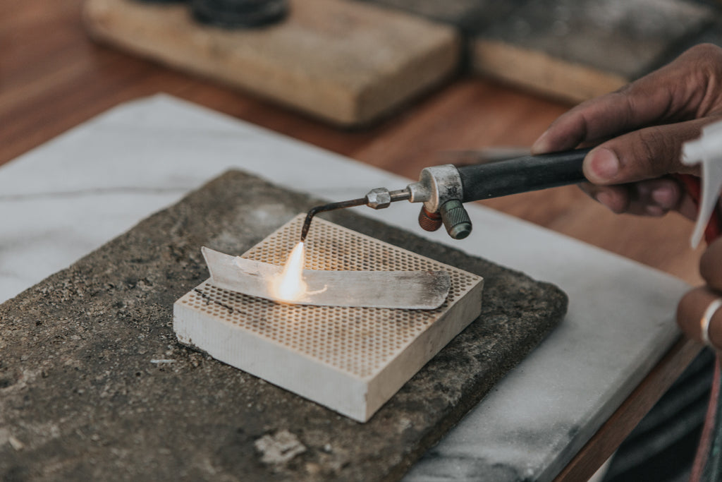 Annealing the recycled silver. A sustainable jewelry studio