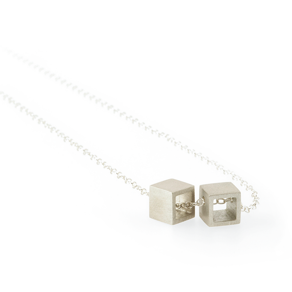 Sustainable silver pendant. This ethical Double Cube Pendant is handmade in Cape Town in recycled silver from e-waste.