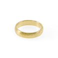 Sustainable gold ring. This artisan crafted Hammered Wedding Band is handmade in Cape Town in recycled gold from e-waste.