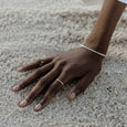 Woman wearing an ethical gold ring. This minimalist Line Ring is handmade in Cape Town in recycled gold from e-waste.