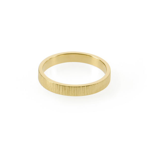 Sustainable gold ring. This artisan crafted Strata Band is handmade in Cape Town in recycled gold from e-waste.
