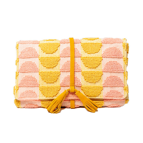 pink and yellow abstract pattern woven cotton clutch with bright yellow suede tassel