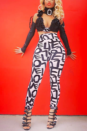 Stylish High Waist Printed Legging Pants. Elastic waist. Spandex material with letter prints.