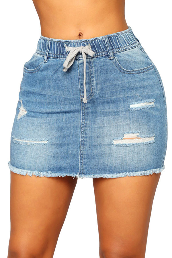 Light Blue Jean Denim Mini Skirt. Distressed look A white string tie in the front