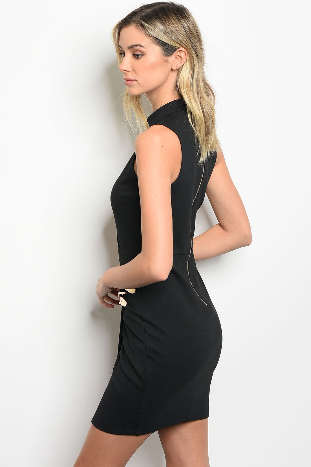 Black Sleeveless body dress with choker. V cutout front. Gold metal buckles on the hemline.