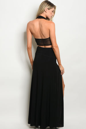 Maxi Black Skirt With A Crop Top. Right side of skirt has a split up to the hip. Crisscross straps across the chest