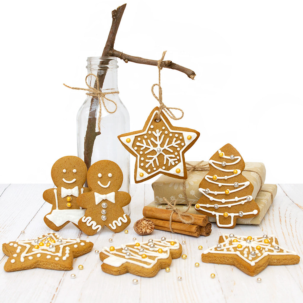Selection of decorated gingerbread including gingerbread men, star and Christmas tree